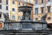 stock photo of spqr  - Fountain in Piazza Santa Maria in Trastevere in Rome