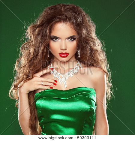 Fashion Beauty Portrait Woman With Long And Healthy Brown Hair Wearing In Elegant Green Dress.