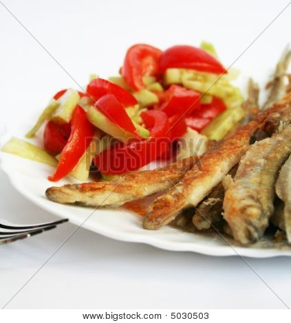 Fish -smelt In Flour Crust Appetizer With Salad On The Plate