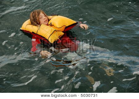 Child Floating In Lifejacket