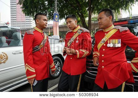 KUALA LUMPUR - AUGUST 31: Troopers from the Armor Corp in ceremonial uniform take a break from duty at the Malaysia's Independence Day celebrations on August 31, 2013 in Kuala Lumpur, Malaysia.