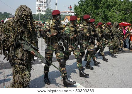 KUALA LUMPUR - AUGUST 31: Snipers and Recce scouts from the 10th Airborne Brigade march on the city streets celebrating Malaysia's Independence Day on August 31, 2013 in Kuala Lumpur, Malaysia.