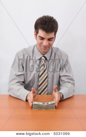 Businessman And Stack Of Money