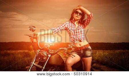 Biker girl with sunglasses and motorcycle