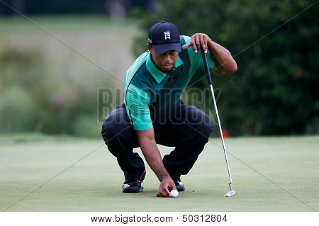 NORTON, MA-SEP 1: Tiger Woods lines up a putt on the green during the third round at the Deutsche Bank Championship at TPC Boston on September 1, 2013 in Norton, Massachusetts.