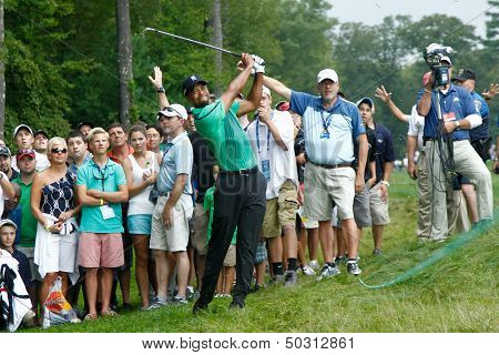 NORTON, MA-SEP 1: Tiger Woods hits out of the rough during the third round at the Deutsche Bank Championship at TPC Boston on September 1, 2013 in Norton, Massachusetts.
