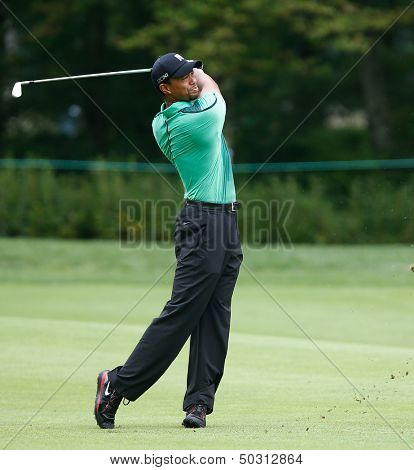 NORTON, MA-SEP 1: Tiger Woods hits a fairway shot during the third round at the Deutsche Bank Championship at TPC Boston on September 1, 2013 in Norton, Massachusetts.