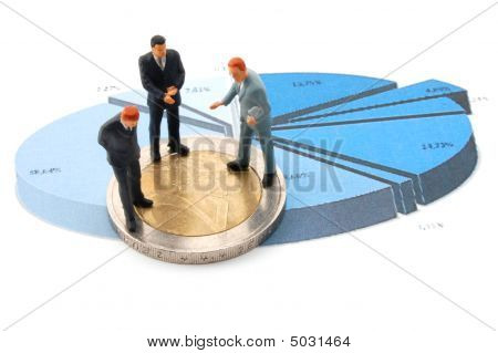 Businessman And Money Over A Chart