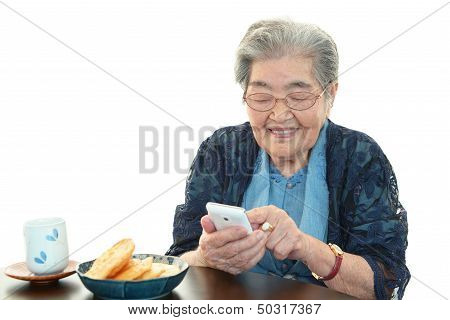 Old woman holding mobile phone
