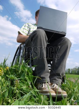 Handicapped Man With Laptop