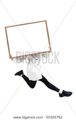 Woman Jumping With Blank Whiteboard Covering Her Face