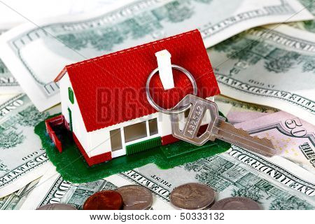 Family house with money and key. Real estate background.