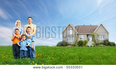 Happy family near new house. Real estate.