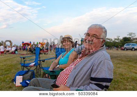 Elderly Spectators Sitting In Deckchairs