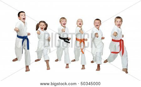 Six young athletes are hitting hand karate kick