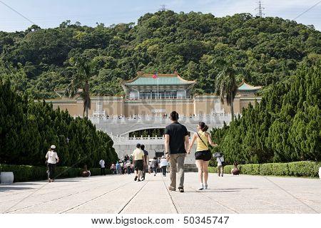 TAIPEI, TAIWAN - SEPTEMBER 4 : Many tourist people walk toward Taipei's National Palace Museum on September 4, 2013 in Taipei, Taiwan, Asia.
