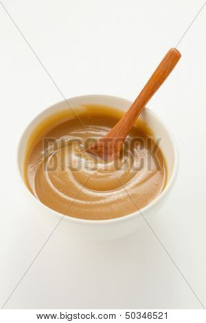 Caramel sauce in bowl, close up
