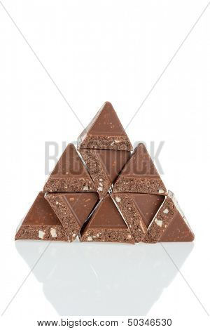 Pieces of chocolate stacked in pyramid