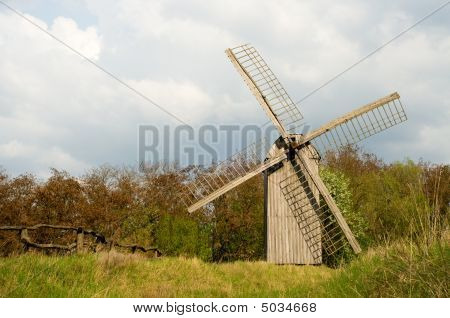 Old Windmill And Wooden Fence