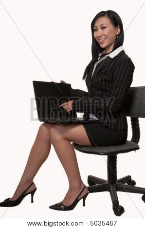 Woman Sitting And Working On Laptop