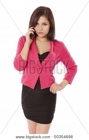 Young Woman In Business Outfit Is Very Angry While On The Phone.