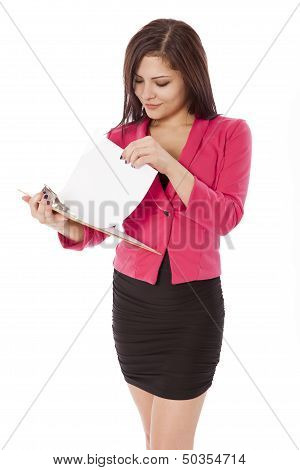 Young Business Woman Looks Through A Project.