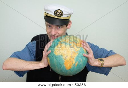 Guy In A Sea Uniform Cap With Globe