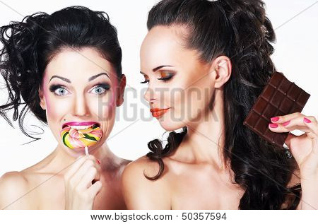 Glam. Couple Of Funny Women Holding Sweets. Positive Emotions. Vitality