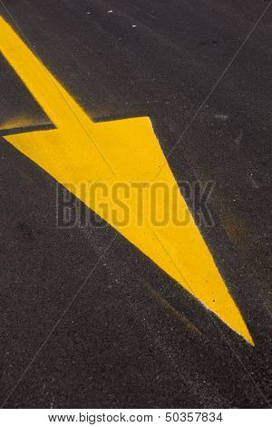 Yellow Arrow On Asphalt