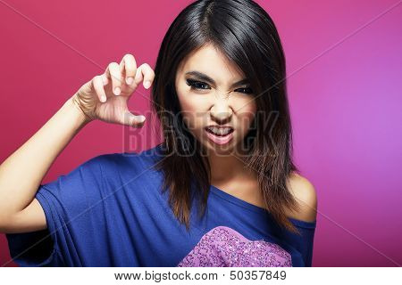 Expressive Asian Female with Threatening Gesture