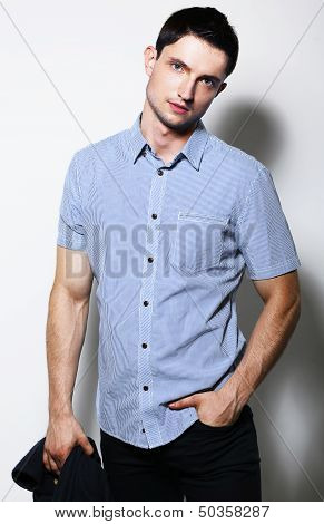 Successful Handsome Stylish Young Man In Blue Shirt Standing