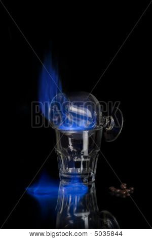 Flaming sambuca over black