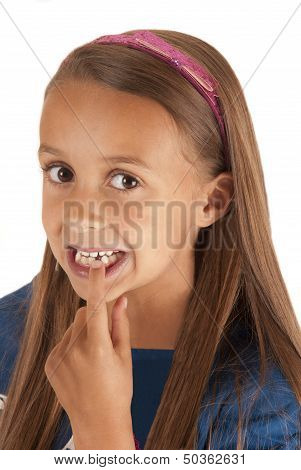 Young Girl Pointing At Missing Tooth With Pink Headband