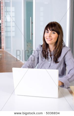 Business Woman In Modern Office With Laptop And Coffee