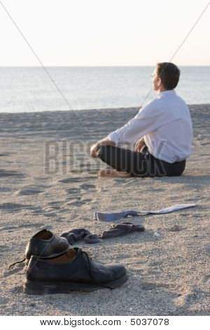Businessman Relaxing On A Beach