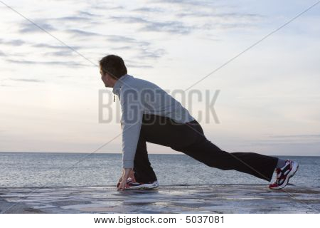 Man Doing Exercises At The Sea
