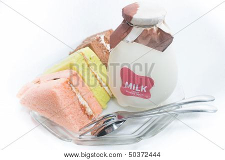Chiffon Cakes With A Bottle Of Milk On The Plate
