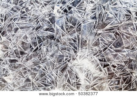 Ice Crystals Over Frozen Puddle