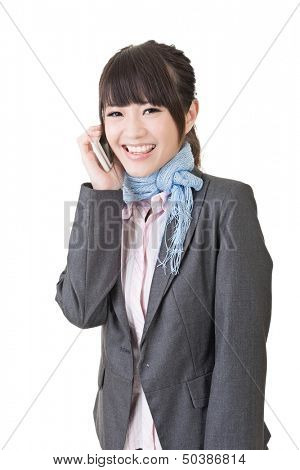 Young asian business woman using cell phone. Half length portrait. Isolated on the white background.