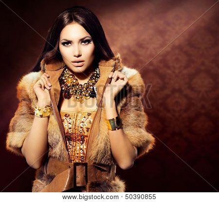 Beauty Fashion Model Girl in Fox Fur Coat. Beautiful Woman in Luxury Red Fur Jacket