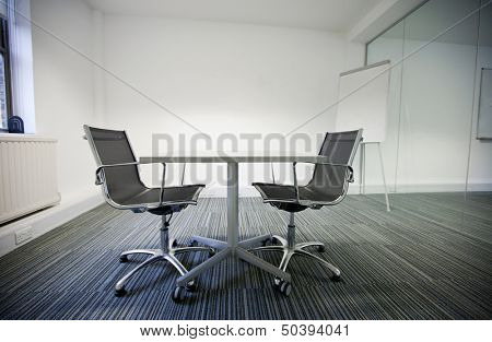 Side view of small table and two chairs in office