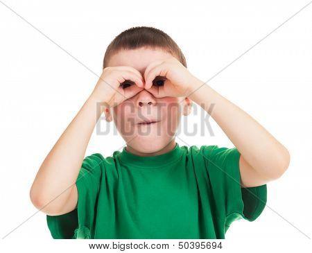 boy looks through his hands like binoculars
