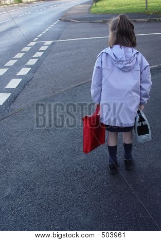 Child On Way To School Getting Ready To Cross The Street.