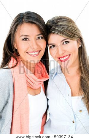 Beautiful girl friends looking happy - isolated over a white background