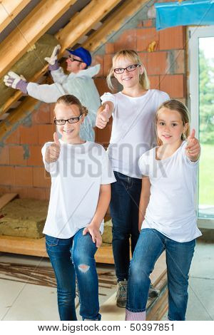 Engineer or father with daughters or daughter with friends building the roof with insulating material