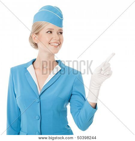 Charming Stewardess Dressed In Blue Uniform Pointing The Finger On White Background