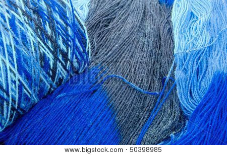 Cones And Skeins Of Blue Yarn