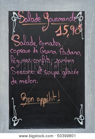 Menu Board With Advertisement At A French Restaurant