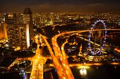 SINGAPORE - APRIL 15: A view of city from roof Marina Bay Hotel in night on April 15, 2012 on Singap