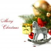 stock photo of wooden horse  - Christmas composition with wooden toy rocking horse  - JPG